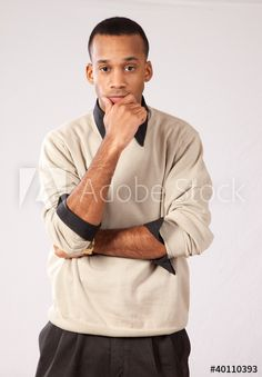 Too young? -- Handsome black man standing, hand on chin thinking