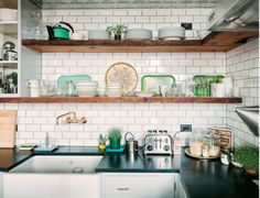 White subway tile, dark grey grout and open wooden shelves