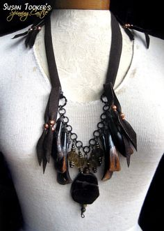 TARANIS CONSORT - Petrified Wood Tribal Amulet Necklace with Buffalo Teeth by Susan Tooker of Spinning Castle