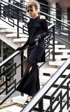 Layer unexpected pieces to make an all-black outfit interesting.