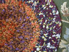Toothbrush Rug made with recycled batik fabric. Designer/Maker Julia K Walton of Fire Horse Textiles