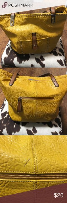 Mustard yellow with gold studs purse. Mustard yellow with gold studs purse. It has a pen mark on the back. Please see the third photo. Bags Shoulder Bags