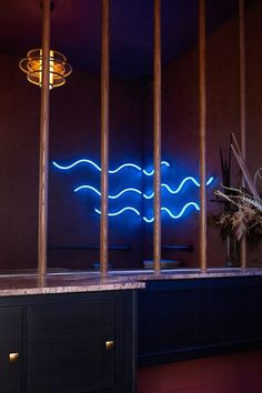 Darker pinks are used for the textured bathroom walls, which are decorated with curved, wave-like neon lights. Nostalgic Art, Cyndi Lauper, Salon Design, Dezeen, Colorful Furniture, Neon Lighting, Bathroom Wall, Salons, Art Deco