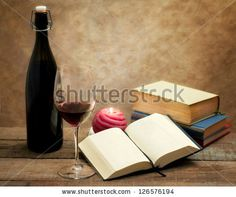 red wine glass with old novel books by Donatella Tandelli, via Shutterstock