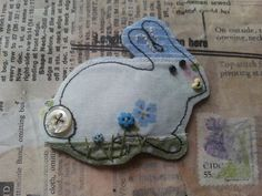 spring easter bunny fabric brooch pin badge free motion embroidery with vintage shell button and hand embroidered details  $18.35