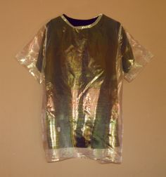 Transparent aurora borealis fabric over a black tee.