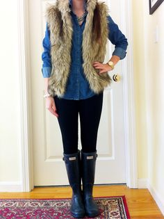All of the essentials! Chambray shirt, faux fur vest, chunky necklace, men's watch, hunter boots!