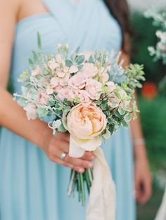 Pink + peachy rose bridesmaid bouquet: http://www.stylemepretty.com/collection/4569/