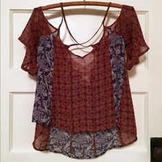 Sheer Boho Hi-Lo Crossback Top Super cute for Spring & Summer!  Tie front, cross back, flowing sleeves. High front with low back. Sheer material. 100% polyester fabric. Tops Blouses