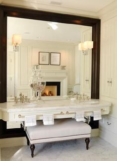 I would need bigger sconces but this bathroom is fabulous