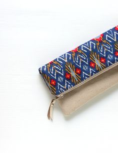Fold Over Clutch Foldover Clutch Sapphire Blue Indonesian Ikat Evening Clutch, Linen Cotton Folded Handbag $33.00 by hennyseashell, an Etsy shop shipping worldwide from Semarang, Central Java