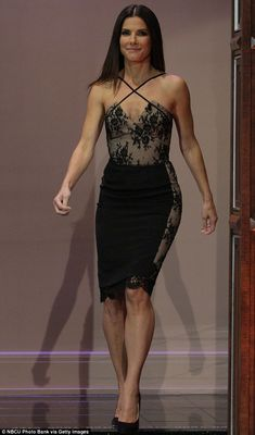 Racy in lace: Sandra Bullock stunned on The Tonight Show With Jay Leno on Tuesday night wearing a stunning black and nude lace dress with criss-cross detailing for her appearance