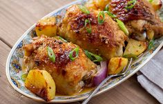 Crisp-tender baked garlic chicken and potatoes— This is your new go-to quick and easy dinner for the family! Chicken thighs, potatoes and red onion, bake everything in one single pan with just a s…