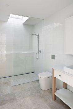 All-white Bathroom With Glass Shower Area And Skylight - Decoist on Home Bathroom Ideas 614 Beach House Bathroom, Laundry In Bathroom, Budget Bathroom, Bathroom Renos, Skylight Bathroom, Bathroom Makeovers, White Bathroom Interior, All White Bathroom, Modern Bathroom
