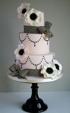 Parisian Chic Wedding Cake, black and white anemones and striped ribbon with black pearl like drops
