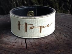 A personal favorite from my Etsy shop https://www.etsy.com/listing/235388161/hope-lasered-on-a-white-leather-cuff