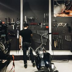 Motorcycle garage with black peg board. Motorcycle Workshop, Motorcycle Shop, Motorcycle Garage, Motorcycle Style, Garage Tool Organization, Tool Storage, Garage Storage, Craft Storage, Shop Organization