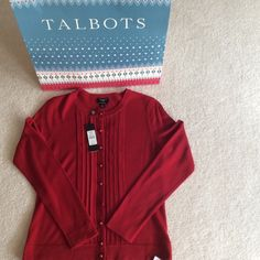 ❤️❤️PERFECT CARDIGAN❤️❤️NWT Beautiful red cardigan.  New with tags. Lightweight Pure Italian soft merino wool.  Button front.  Pleating on each side of buttons.  Extra buttons included.  Gift box included also.  Great gift to give or keep for yourself!!  In red.  Size petite petite. Talbots Sweaters Cardigans
