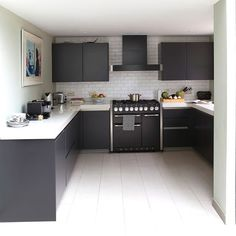 The Stainless steel side panels on this Mercury range cooker in ash black work well with this contemporary kitchen design.
