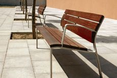 Bench with dark brown ipe wooden slats and metal sides and legs