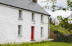 Home Extensions Cork - A traditional XVIII century farmhouse has been fully renovated and extended to the highest level of energy efficiency and comfort. Farmhouse Renovation, House Extensions, Entrance Doors, Full House, Greenhouses, Cork, Cottage, Backyard, House Design