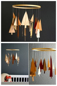 DIY Wood Veneer Pine Forest Tree Mobile. Simple if you have the materials. There is a link to veneer woods, but there must be something cheaper out there! Tutorial from You Are My Fave here.