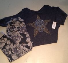 Floral track pants and skull star boxy top at Nicci