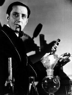 Basil Rathbone as Sherlock in a smoking jacket. Detective Sherlock Holmes, Sherlock Holmes Stories, Adventures Of Sherlock Holmes, Elementary My Dear Watson, Jeremy Brett, John Gray, Smoking Jacket, Miss Marple, Doctor Johns