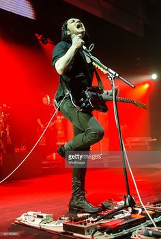 Brian Molko of Placebo performs on stage at Brixton Academy on December 17, 2013 in London, United Kingdom.