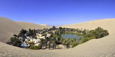 """Your eyes are telling the truth.  Huacachina is no mirage -- it's a tiny town of less than 100 people, located in the middle of the Peruvian desert.  The tourist hotspot is back in the news this week, but people looking to visit the """"oasis o..."""