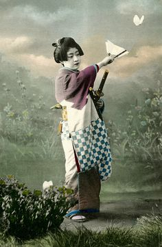A Geisha from the Shinbashi geisha district in Tokyo, dressed to dance a male role in a Genroku odori, around 1905