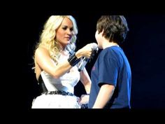 Carrie Underwood brings 12-year-old boy on stage for his first kiss