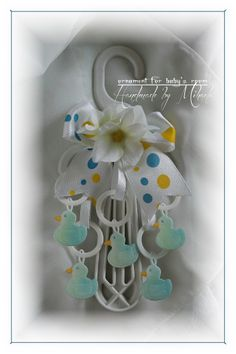 I made this work as a ornament for baby's room. I used as a base an plastic support and than I decorated with Duck Rattle from. Baby Room, Ornaments, Handmade, Crafts, Decor, Hand Made, Manualidades, Decoration, Nursery