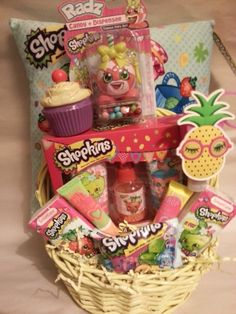 Join the new kids craze with Shopkins! Designed by Moose toys in Australia. Unique named grocery items can capture any child's imagination. Included in this Shopkins basket are Shopkins pillow Blue, apple blossom scented body wash 2 fl. oz., strawberry scented body splash 1.5 fl. oz., cupcake chic body lotion 2 fl. oz., 2-2 ply 10 count Shopkins tissue, bubble cupcake, blinky pineapple sanitizer case, cotton antibacterial hand sanitizer, Shopkins in a shopping bag, Lolli Poppkins candy and…
