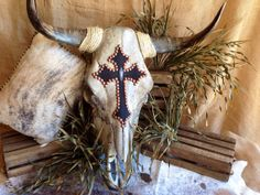 Check out our cross steer skull selection for the very best in unique or custom, handmade pieces from our art & collectibles shops. Cow Skull Decor, Cow Skull Art, Skull Head, Western Crafts, Western Decor, Bull Skulls, Animal Skulls, Painted Deer Skulls, Hand Painted
