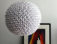 5 Crafty Paper Lanterns to Create Quickly like this Faceted DIY Paper Lantern.