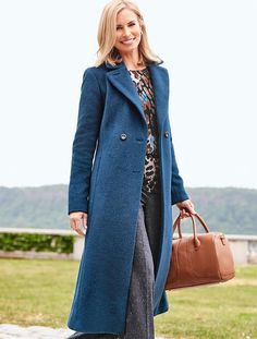 An iconic, double-breasted luxurious long wool coat.