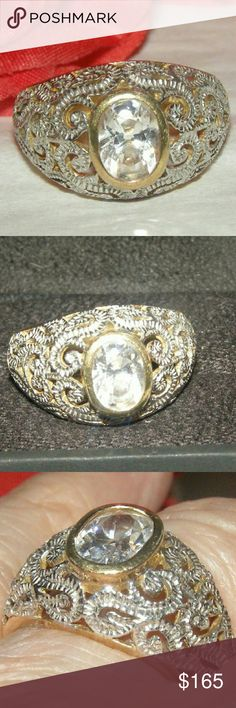 A Beauty Silver Filigree Great yellow gold silver filigreed ring.A mounted cz stone in middle of a beautiful ring.SE marked inside. Jewelry Rings