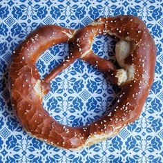 Laugenbrezel (Traditional German Pretzels) by Saveur. At the Hofbräuhaus beer hall in Munich, these giant pretzels, which have a similar chew to bagels, are served with soft butter. German Pretzel Recipe, Beer Recipes, Cooking Recipes, Bavarian Pretzel, German Bread, Oktoberfest Food, Pretzels Recipe, Soft Pretzels, The Best