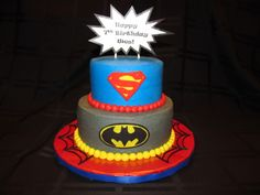 """Superhero Cake - I made the Superman and Batman emblems out of fondant; cake is iced in buttercream; printed the """"BAM"""" Happy Birthday sign on paper (taped to lollipop sticks); covered the cake board in red wrapping paper, then in clear contact paper and piped the spider webs with buttercream"""