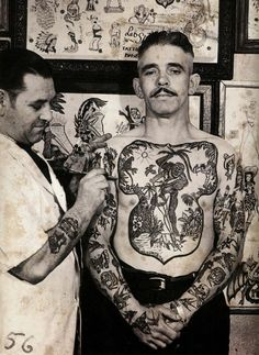 Mr. Les Skuse 'Champion Tattoo Artist of All England' at work in the 50's