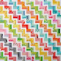 WOW- look what 3 simple rows can do! Red Pepper Quilts: Scrap Buster Quilt Top