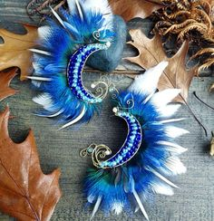 NEW feather ear cuffs available soon ❤ Festival Accessories, Blue Feather, Wire Weaving, Feathered Hairstyles, Tribal Fashion, Pet Accessories, Hippie Style, Headdress, Ear Piercings