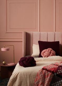 Incy Interiors soft pink velvet Sybilla bedhead, pink wall, pink light