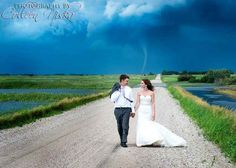 This Couple's Wedding Pictures Were Photobombed By A Tornado And It Looks Totally Badass