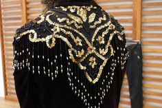 DIY Decorated Blazer. Layer a regular blazer with a vintage beaded shawl (you can buy them for pretty cheap on etsy)