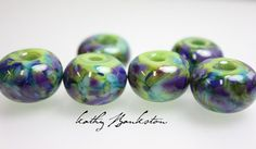 These beads turned out so pretty. They are a base of the kiwi green rolled in a frit that has all colors of purple, blue, and greens.