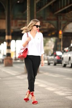 Blogger Brooklyn Blonde in black pants, a white top, a red bag and shoes