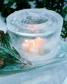 ice lantern- all you need is a bucket, a smaller bucket or bowl,some rocks, some duct tape, and some candles! pretty and dirt cheap!