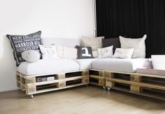 DIY couch. Lounge room. Pallet couch with lots of pillows
